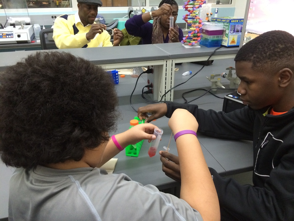 Kestrel Heights students getting hands-on lab experience extracting DNA from strawberries. Photo credit: Julie Urban.